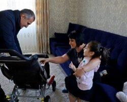 Глава РЮО подарил девочке инвалидную коляску